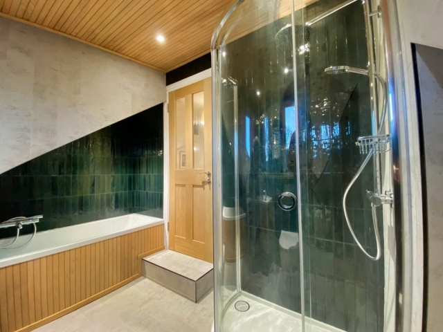 New bathroom installation within attic conversion, dormer room.