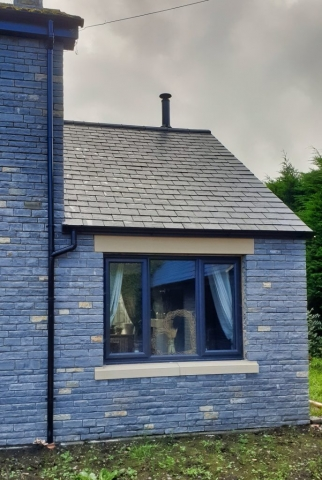 Blue Lias stone and slate roof, side extension.