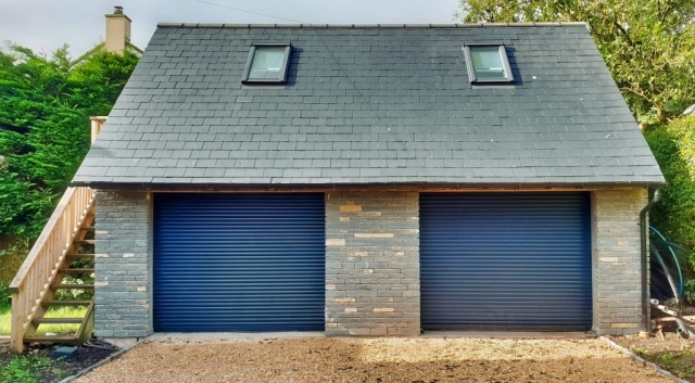 Blue Lias stone and slate roof double garage.