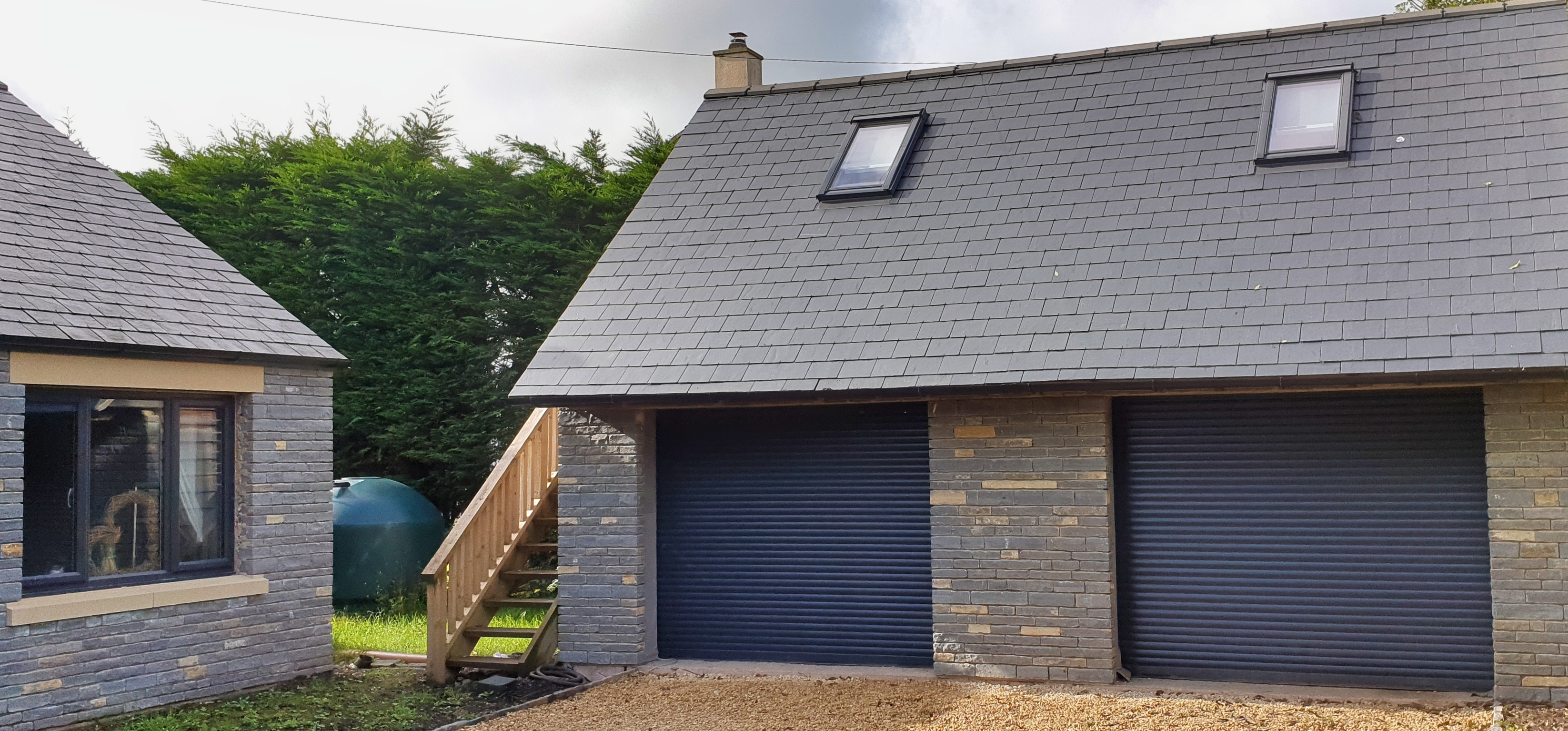 Blue Lias stone and slate roof, side extension and double garage.